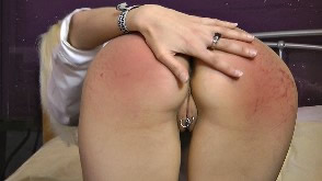 A sore red bottom for this schoolgirl
