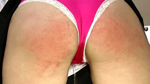 Katie is spanked for wetting her panties