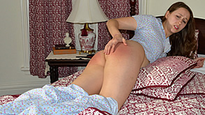 Joelle feels the cane on her bare bottom